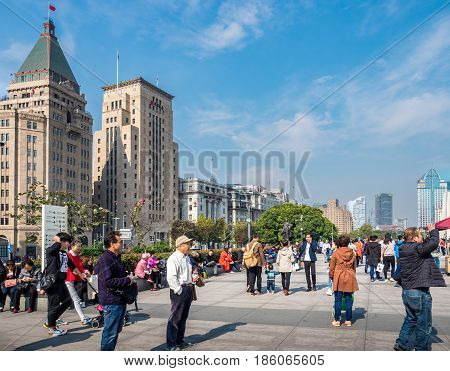 Shanghai, China - Nov 4, 2016: Along The Bund Sightseeing Avenue near Chen Yi Square. Popular destination for local and foreign visitors.