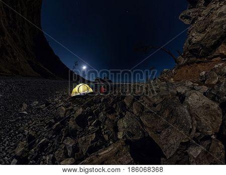 Panorama Of  Man At  Tent On  Stone Beach On Shore Of Lake Baikal At Night