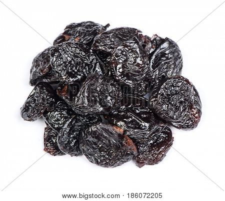 Heap of prunes isolated on white background