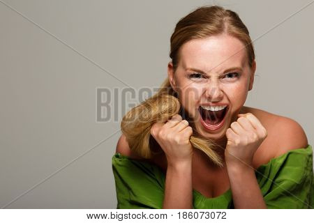 Screaming model with bare shoulders