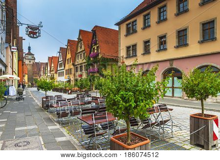 Rothenburg ob der. Tauber, Germany - September 2016: at the streets of another charming town on the Romantic Road