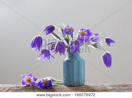 the spring flowers in vase on white background