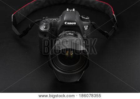 GOMEL BELARUS - May 12 2017: Canon 6d camera with lens on a black background. Canon is the world's largest SLR camera manufacturer