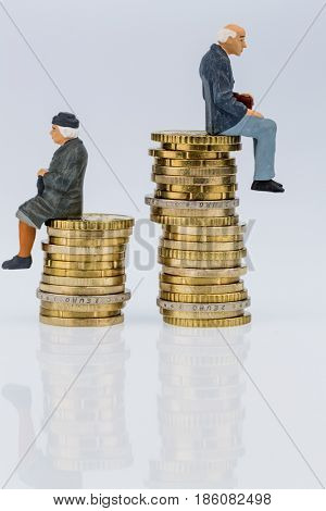 pensioners and pensioner sitting on money stack