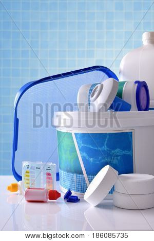 Chemical Cleaning Products For Pool With Blue Mosaic Background Vertical