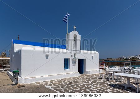 White church in town of Naoussa, Paros island, Cyclades, Greece