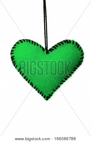 green felt hearts on a white background valentines composition copy space
