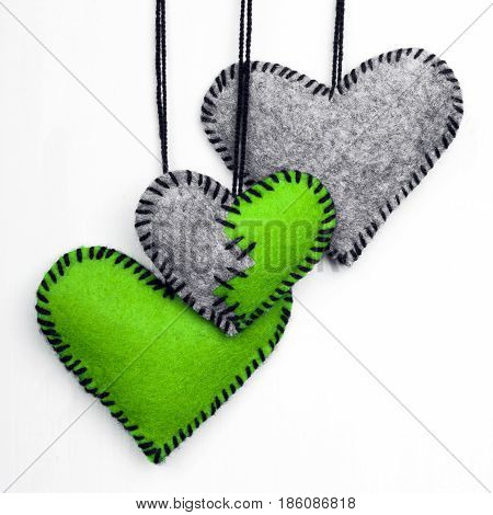 Three felt heart on a white background valentines composition copy space