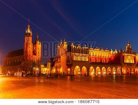 Market square with Sukennice st Mry cathedral in Krakow at night, Poland
