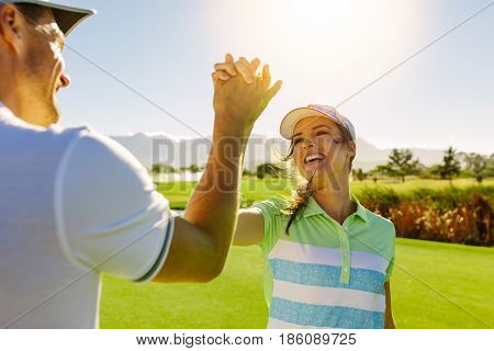 Golfers Giving High-five At Golf Course