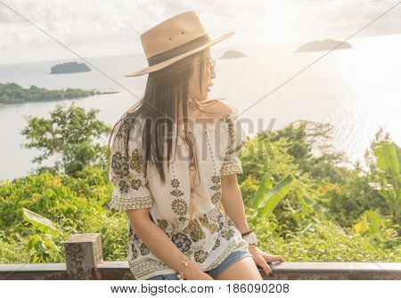 Asia Women sitting on the sea view point travel Koh Chang Trad Thailand