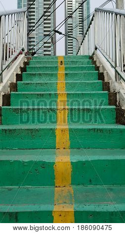 Overpass stairs green and background . .