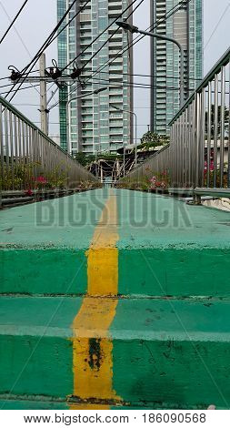 green overpass and background cable . .