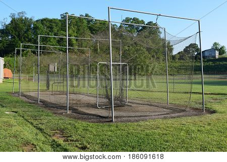 Spring baseball pitchers practice throwers cage and field