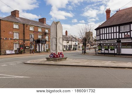 Chirk Wales UK - April 6 2017: The Welsh town of Chirk or Y Waun (in Welsh) dating back to the 11th century on the border of Wales and England with it's old coaching inn and war memorial