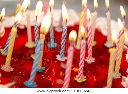 Celebratory cake and burning candles (shallow dof)