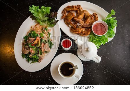 Thai food background. Dishes of thai cuisine. Tom yum soup pad thai noodles thai fried rice with pork and vegetables khao phat mu green papaya salad som tam thai fruits