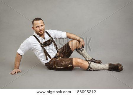 An image of a man in bavarian traditional lederhosen