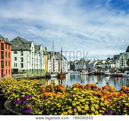 Alesund, Norway - May 7, 2017: Seafront of town and sea port Alesund, Norway.
