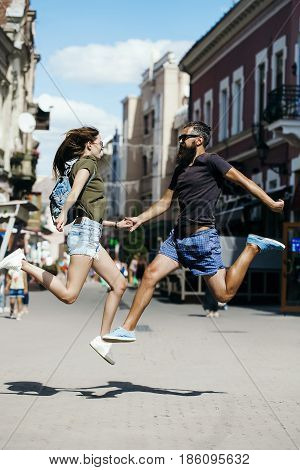 Couple In Love Jumping On City Street