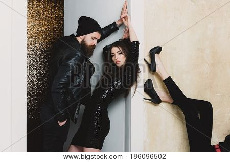 Young Couple And Female Legs