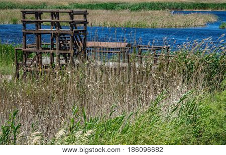 Closeup of wooden viewpoint to Nature and marsh