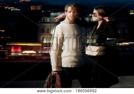 Couple Of Friends, Man, Girl On Blurred Night City Illumination