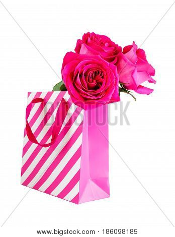 Pink shopping bag and pink roses isolated on white background