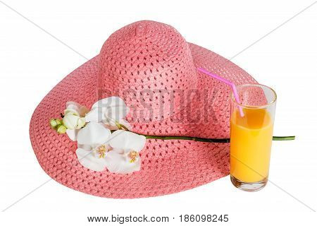 Pink summer hat glass of orange juice and white orchid isolated on white background