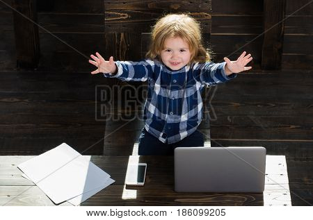 Happy Boy Kid In Office With Laptop, Phone, Paper Sheet