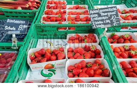 Fresh Strawberries In Plastic Boxes For Sale At City Market. Lucerne, Switzerland