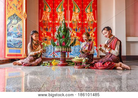 KHONKHAEN THAILAND - DECEMBER 20 2015: Thai northeastern traditional liftstyle in making rice offering and garland for any special occasions and events in Buddhist temple in Khonkhaen.