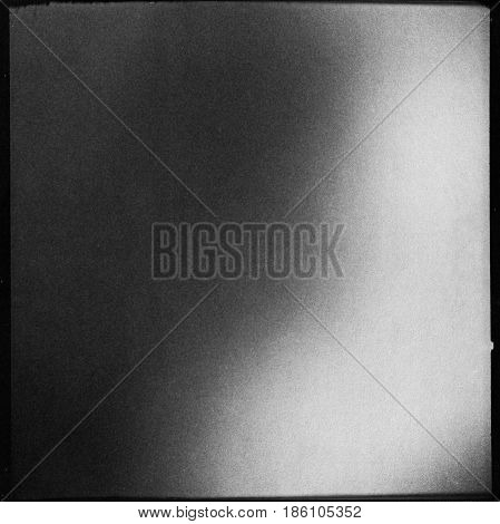 black and white medium format film background with heavy grain and light leak