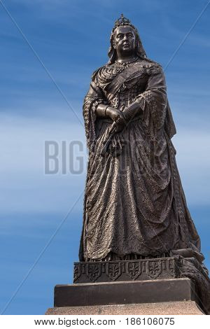 Auckland New Zealand - March 5 2017: Closeup of Black metal statue of Queen Victoria in Albert Park under blue sky.
