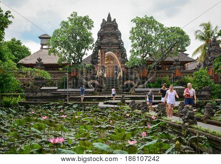People Visit The Local Temple In Bali, Indonesia