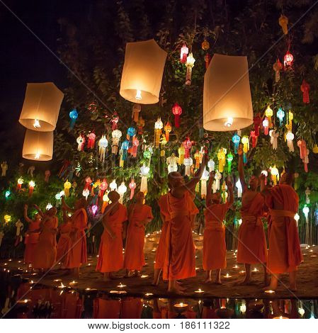 CHIANG MAI THAILAND - NOVEMBER 06 2014: Loy Krathong ceremony: Buddhist monks release sky lanterns to pay homage to the Buddha in Phan Tao Temple. Beautiful buddhist monks.
