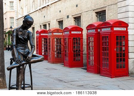 LONDON, UK - APRIL 8, 2007: Traditional red telephone boxes and sculpture on April 8, 2007 in London, UK