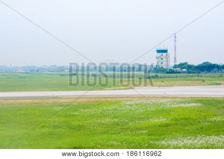 aeronautical tower cotrol air plane and green meadow