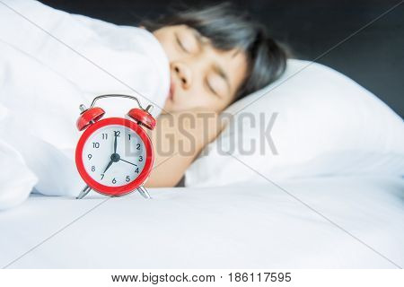 girl sleeping on the bed seven o'clock morning time