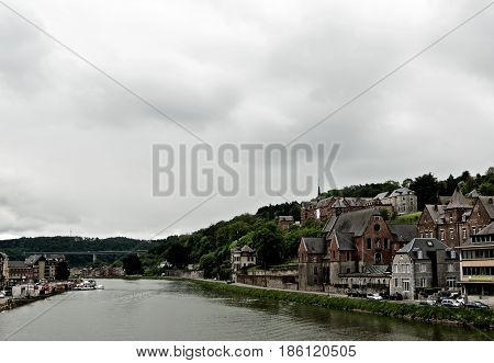 Landscape of Meuse River and Side View on Maison Leffe in Cloudy Day Outdoors. Dinant Belgium