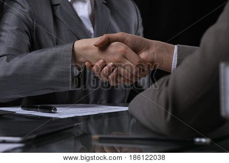 Businesspeople or lawyers shaking hands at meeting endless. Low key lighting.