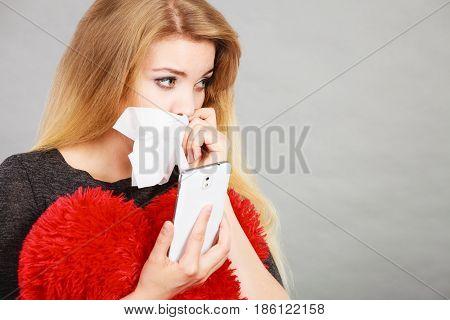 Sad Heartbroken Woman Looking At Her Phone