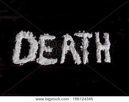 Cocaine drug powder in death word shaped