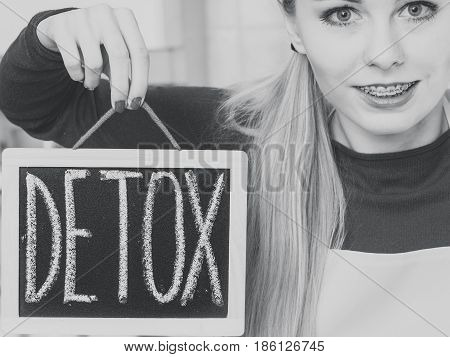 Happy Woman Holding Board With Detox Sign