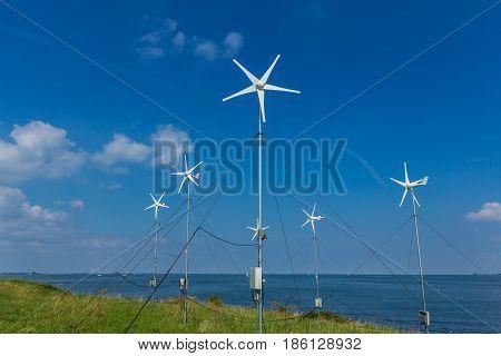 Pampus island ijmeer the Netherlands - August 30 2016: micro grid wind turbines