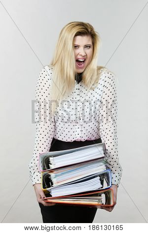 Woman Holding Heavy Colorful Binders With Documents