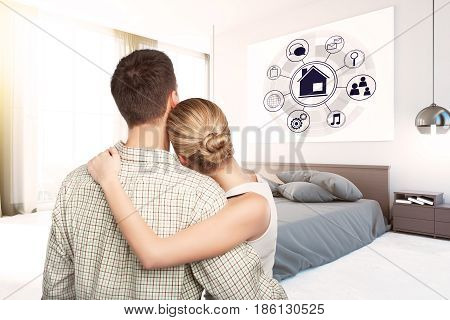 Back view of young couple looking at circular futuristic interface of smart home automation assistant. 3D Rendering