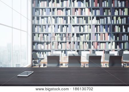 Close up of dark wooden surface with smartphone in library with huge bookcase workplace and city view. 3D Rendering