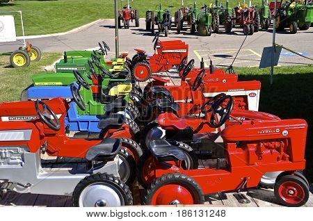YANKTON, SOUTH DAKOTA, August 20, 2016: The John Deere Formal, and Ford pedal tractors are displayed at the Yankton, South Dakota Riverboat Days held annually the 3rd weekend of August.