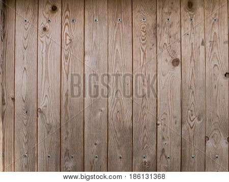 Wooden brown planks with metallic rivets background